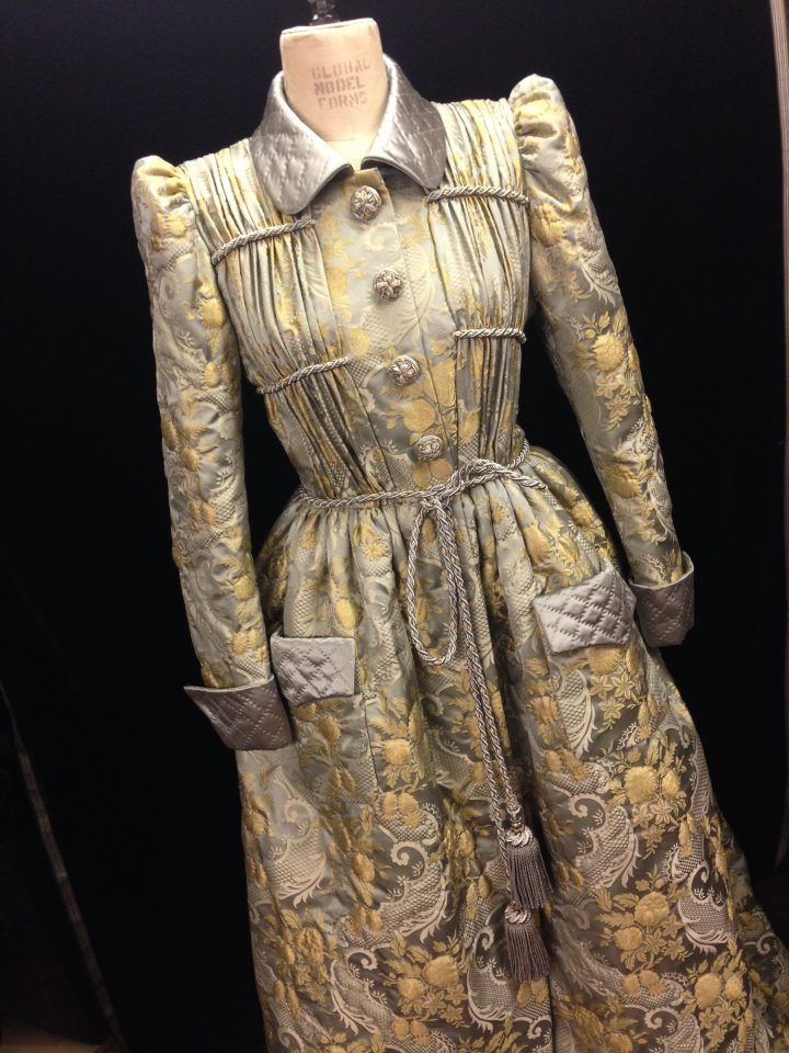 19th Century housecoat in trapunto quilted silk brocade, trimmed with passementerie