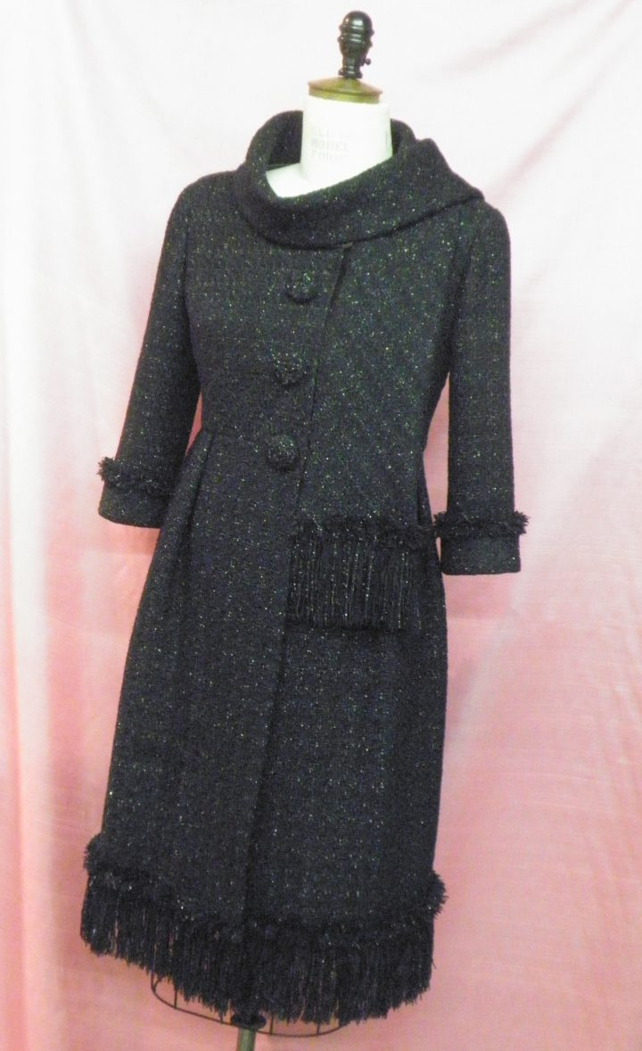 Coatdress in black metallic Linton tweed, self trimming